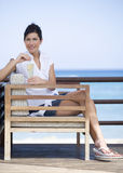 A woman relaxing with a drink Royalty Free Stock Photography