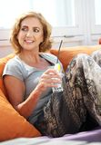 Woman relaxing with a drink at restaurant Royalty Free Stock Photo