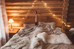 Cozy winter weekend in log cabin stock image