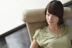 Woman Relaxing On Easy Chair Stock Photos