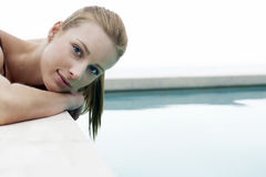 Woman Relaxing On Edge Of Swimming Pool Royalty Free Stock Images