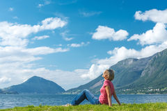 Woman relaxing enjoying at the fjord coast Royalty Free Stock Images