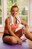 Woman relaxing after an exercise workout Royalty Free Stock Image