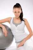 Woman relaxing after exercises with fitness ball Royalty Free Stock Photography