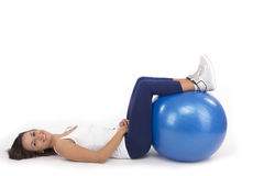 Woman relaxing between exercises. Stock Images