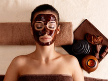 Woman relaxing with facial mask on face Royalty Free Stock Images