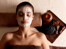 Woman relaxing with facial mask on face at beauty salon Royalty Free Stock Photography