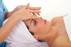 Woman relaxing with facial massage Stock Photography