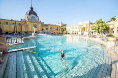 Woman relaxing at the thermal bathes in Budapest. Woman relaxing at the famous Szechenyi thermal bathes in Budapest, Hungary royalty free stock images