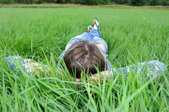 Woman relaxing in field Royalty Free Stock Photos