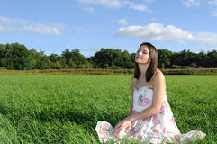 Woman relaxing on field Stock Photos