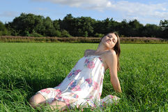 Woman relaxing on field Royalty Free Stock Photography