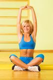 Woman relaxing after fitness Stock Photography