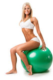 Woman relaxing on fitness ball Stock Photography