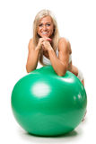 Woman relaxing on fitness ball Royalty Free Stock Photos