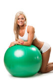 Woman relaxing on fitness ball Royalty Free Stock Photo