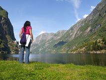 Woman relaxing in the fjord of Gudvangen Stock Photography