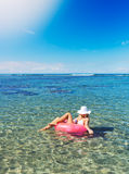 Woman relaxing and floating in the ocean Royalty Free Stock Photography