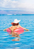 Woman relaxing and floating in the ocean Royalty Free Stock Photo