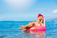 Woman relaxing and floating in the ocean Royalty Free Stock Images