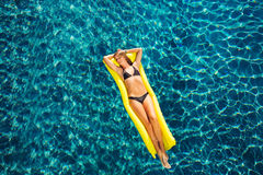 Woman Relaxing Floating on Raft in Pool Royalty Free Stock Images