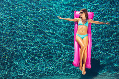 Woman Relaxing Floating on Raft in Pool Royalty Free Stock Photo