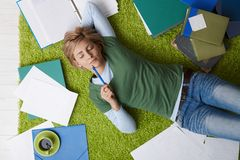 Woman relaxing on floor Stock Images
