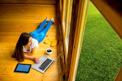 Woman relaxing on the floor in wooden house Stock Photos
