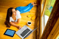 Woman relaxing on the floor in wooden house Stock Photography