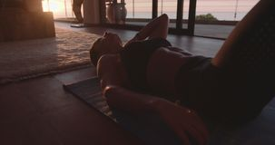 Woman relaxing on floor after workout stock footage