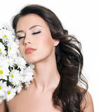 Woman relaxing with flowers Stock Images
