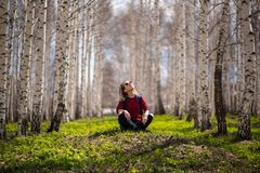 Woman relaxing in forest Royalty Free Stock Image