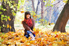 Woman relaxing in the forest, autumn outdoor. Stock Images