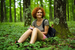 Woman relaxing in the forest Stock Photography
