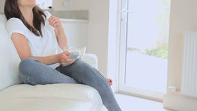 Woman relaxing in front of the television stock footage