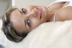 Woman Relaxing On Fur Bed Royalty Free Stock Image