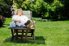 Woman relaxing in the garden Stock Image