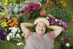 Woman Relaxing In Garden Royalty Free Stock Images