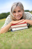 Woman relaxing in garden with books Stock Photography