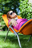 Woman relaxing in a garden Royalty Free Stock Photos