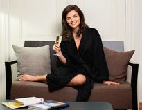 Woman relaxing with glass of champagne Royalty Free Stock Images