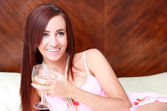Woman Relaxing with a Glass of Wine Stock Images