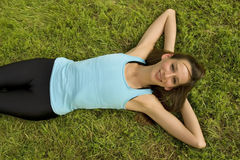 Woman relaxing on grass Stock Image