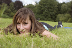 Woman relaxing on grass Royalty Free Stock Photo