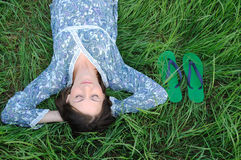 Woman relaxing on grass Stock Photo