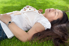 Woman relaxing on grass Royalty Free Stock Photos