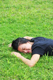 Woman relaxing grass Royalty Free Stock Images