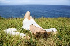 Woman relaxing in grass. Royalty Free Stock Photo