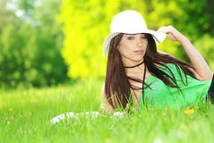 Woman relaxing in the grass Stock Images