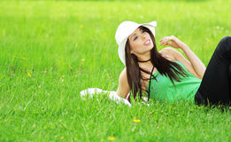 Woman relaxing in the grass Royalty Free Stock Photo